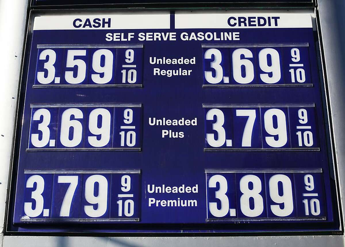 A sign shows the price of gasoline, which is discounted for customers paying cash, at Twin Peaks Auto Care on November 15, 2013 in San Francisco, Calif.