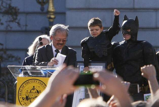 """Miles Scott holds up his fist in victory with San Francisco Mayor Ed Lee after Scott's Make-A-Wish experience as """"Batkid"""" in San Francisco on Friday, Nov. 15, 2013. Photo: Raphael Kluzniok, The Chronicle"""