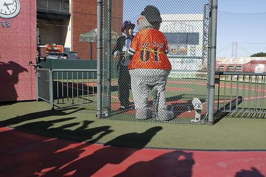 The Penguin who has kidnapped SF Giants' mascot Lou Seal is tied up at AT&T Park  in San Francisco Ca., on Friday Nov. 15, 2013.  Five year old Miles from Tulelake in Siskiyou County loves superheroes and Batman in particular. After battling leukemia since he was a year old Miles will fulfill his dream of becoming Batkid being swept around the city performing superhero feats from rescuing a damsel in distress to thwarting a bank robbery and even chasing down the Penguin through AT&T Park Photo: Michael Macor, The Chronicle
