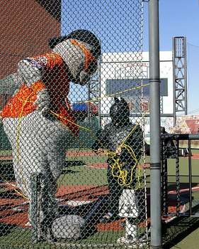 Batkid rescues the San FRancisco Giants' mascot Lou Seal after being kidnapped by the Penguin at AT&T Park  in San Francisco Ca., on Friday Nov. 15, 2013.  Five year old Miles from Tulelake in Siskiyou County loves superheroes and Batman in particular. After battling leukemia since he was a year old Miles will fulfill his dream of becoming Batkid being swept around the city performing superhero feats from rescuing a damsel in distress to thwarting a bank robbery and even chasing down the Penguin through AT&T Park Photo: Michael Macor, The Chronicle