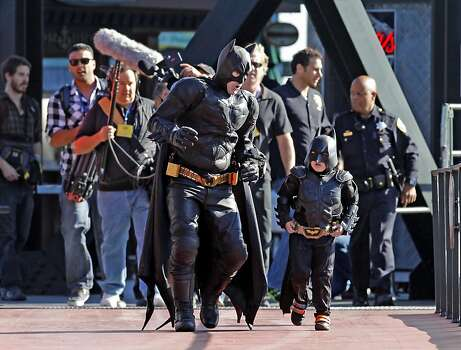 Batman and Batkid respond to AT&T Park after reports that the Penguin has kidnapped SF Giants mascot Lou Seal in San Francisco Ca., on Friday Nov. 15, 2013.  Five year old Miles from Tulelake in Siskiyou County loves superheroes and Batman in particular. After battling leukemia since he was a year old Miles will fulfill his dream of becoming Batkid being swept around the city performing superhero feats from rescuing a damsel in distress to thwarting a bank robbery and even chasing down the Penguin through AT&T Park Photo: Michael Macor, The Chronicle