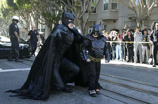 Miles Scott, dressed as Batkid, right, walks with Batman before saving a damsel in distress in San Francisco, Friday, Nov. 15, 2013. Photo: Jeff Chiu, Associated Press