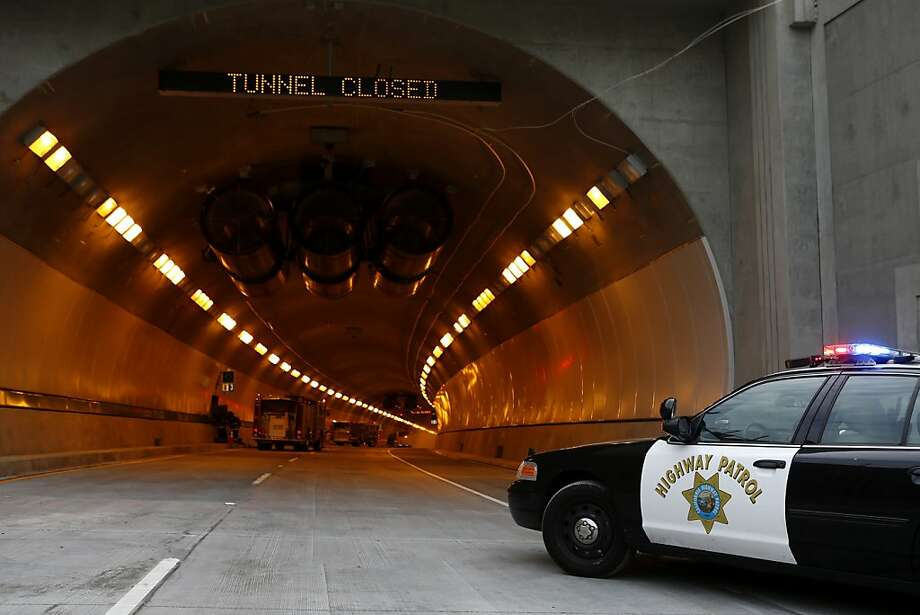 A big rig fire in the right bore of the Caldecott Tunnel caused delays on eastbound Highway 24, CHP said Friday morning. The fire was extinguished, but bore 1 and bore 2 remain closed. Photo: Beck Diefenbach, Special To The Chronicle