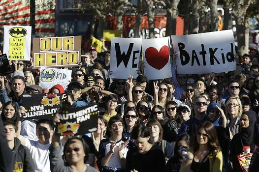 "A crowd holds up signs for Miles Scott, as Batkid, at a rally outside of City Hall in San Francisco, Friday, Nov. 15, 2013. Scott was called into service on Friday morning by San Francisco Police Chief Greg Suhr to help fight crime, as San Francisco turned into Gotham City as city officials helped fulfill the 5-year-old leukemia patient's wish to be ""Batkid,"" The Greater Bay Area Make-A-Wish Foundation says. He was diagnosed with leukemia when he was 18 months old, finished treatment in June and is now in remission, KGO-TV reported. (AP Photo/Jeff Chiu) Photo: Jeff Chiu, Associated Press"