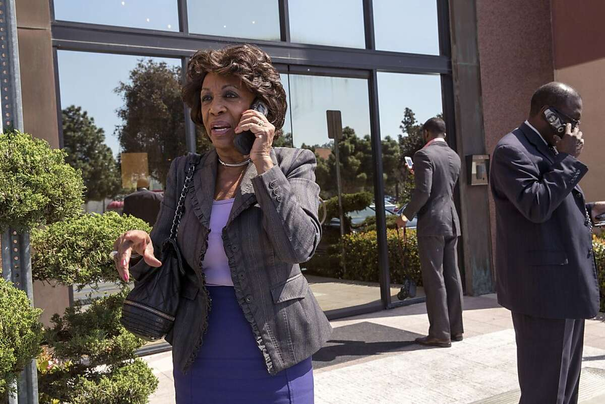 FILE -- Rep. Maxine Waters takes a call before a meeting in her district in Torrance, Calif., March 22, 2013. Waters, the ranking Democrat on the House Financial Services Committee, is opposed to two bills in the works that would undercut the Dodd-Frank financial regulations.