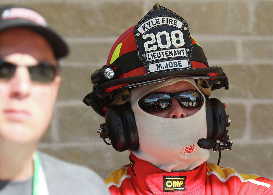 Kyle Fire Department Lt. Matt Jobe wears protective gear while overseeing the Formula One United States Grand Prix afternoon practice session at the Circuit of the Americas near Austin, Texas on Friday, Nov. 15, 2013. Photo: Kin Man Hui, San Antonio Express-News / ©2013 San Antonio Express-News