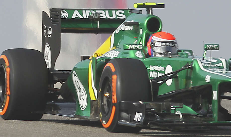 A special message to show support for Philippines victims of Super Typhoon Haiyan is shown on the side of the Caterham F1 car driven by Giedo Van Der Garde during the Formula One United States Grand Prix morning practice session at the Circuit of the Americas near Austin, Texas on Friday, Nov. 15, 2013. AirAsia is heading up a donation and relief campaign for victims of the natural disaster which has affected millions of Filipinos. Photo: Kin Man Hui, San Antonio Express-News / ©2013 San Antonio Express-News