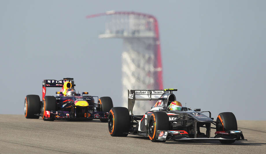 Sauber F1's Esteban Gutierrez (right) drives ahead of current World Champion Sebastian Vettel during the Formula One United States Grand Prix morning practice session at the Circuit of the Americas near Austin, Texas on Friday, Nov. 15, 2013. Photo: Kin Man Hui, San Antonio Express-News / ©2013 San Antonio Express-News