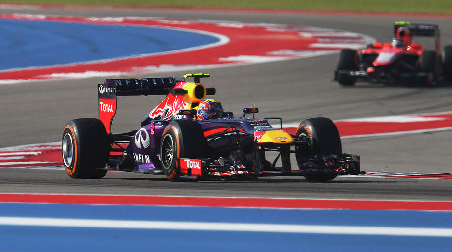 Infiniti Red Bull Racing's Mark Webber (foreground) takes a lap during the Formula One United States Grand Prix morning practice session at the Circuit of the Americas near Austin, Texas on Friday, Nov. 15, 2013. Photo: Kin Man Hui, San Antonio Express-News / ©2013 San Antonio Express-News