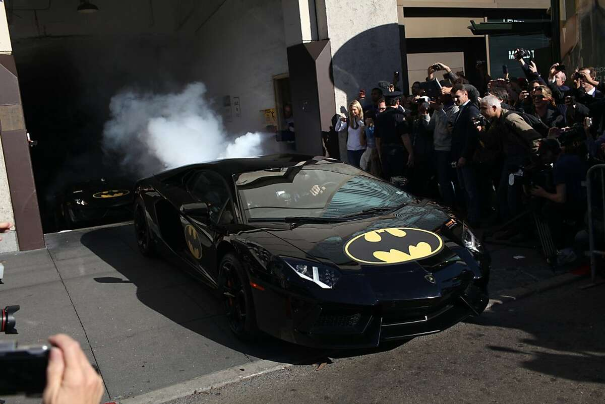 A Lamborghini with Bat-Mobile stickers exits a smoke filled garage ith Miles Scott, 5, during a Make-a-Wish benefit where he saves Gotham as Batkid in San Francisco, Calif., Friday November 16, 2013.