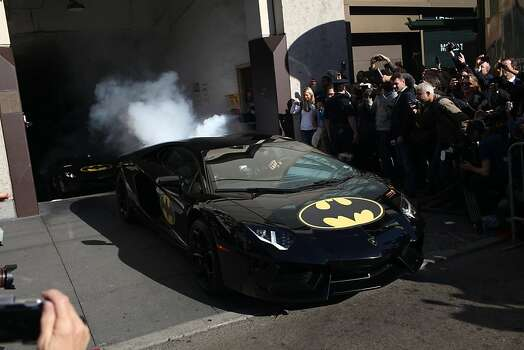 A Lamborghini with Bat-Mobile stickers exits a smoke filled garage ith Miles Scott, 5, during a Make-a-Wish benefit where he saves Gotham as Batkid in San Francisco, Calif., Friday November 16, 2013. Photo: Jason Henry, Special To The Chronicle