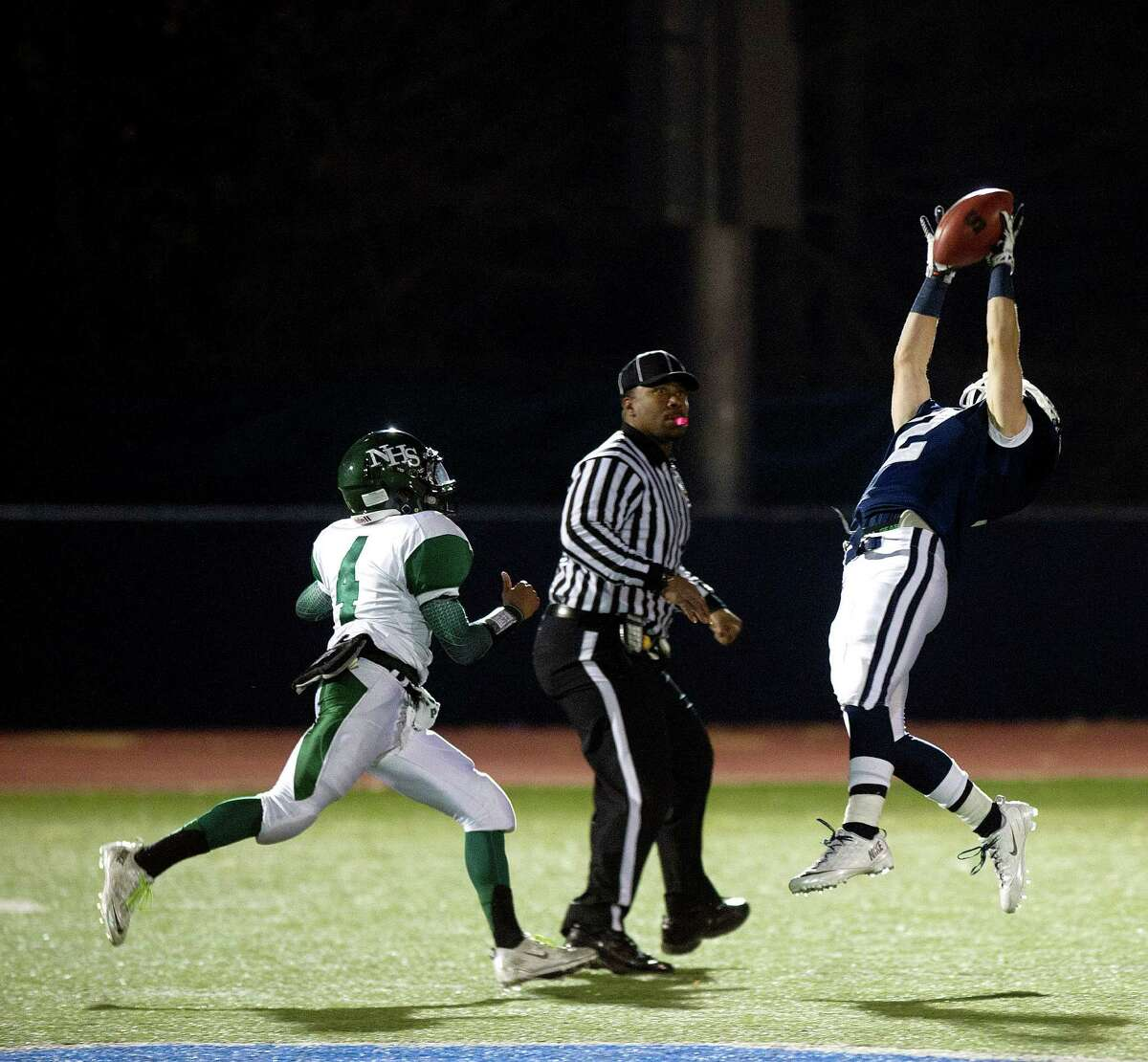 Staples' Will Johnson makes a catch during Saturday's football game at Staples High School in Westport, Conn., on November 15, 2013.
