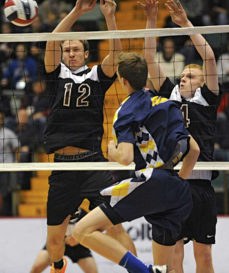 Austin Nydegger, left, and Ben Keppler, right, of Burnt Hills try to block the ball hit by Matt Erickson of Sachem during a state semifinals volleyball match on Friday, Nov. 15, 2013 in Glens Falls, N.Y.  (Lori Van Buren / Times Union) Photo: Lori Van Buren / 00024609A