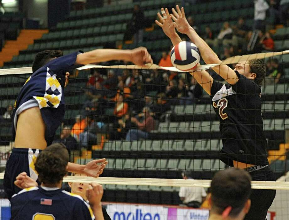 Austin Nydegger of Burnt Hills, right, blocks the ball by Dom Yeager of Sachem at the net for a point during a state semifinals volleyball match on Friday, Nov. 15, 2013 in Glens Falls, N.Y.  (Lori Van Buren / Times Union) Photo: Lori Van Buren / 00024609A