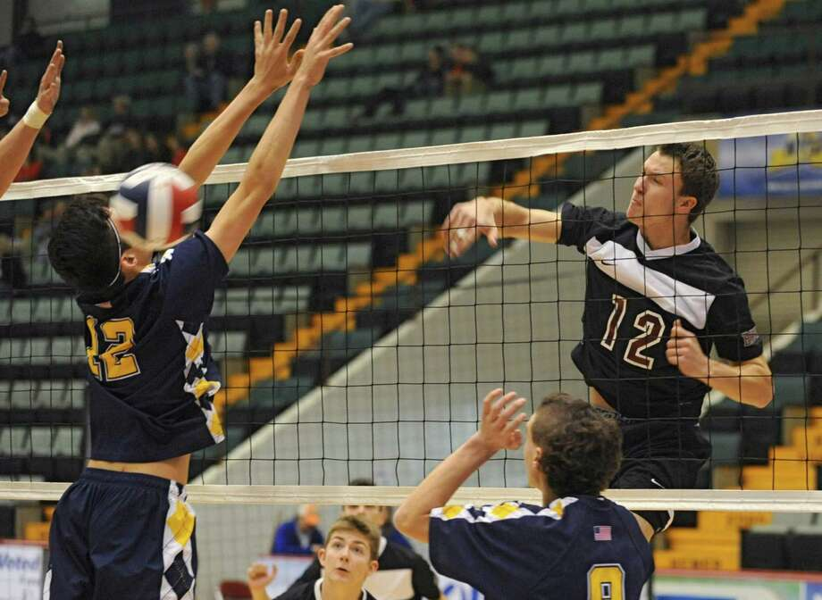 Austin Nydegger of Burnt Hills, right, drills the ball past Dom Yeager of Sachem for a point during a state semifinals volleyball match on Friday, Nov. 15, 2013 in Glens Falls, N.Y.  (Lori Van Buren / Times Union) Photo: Lori Van Buren / 00024609A