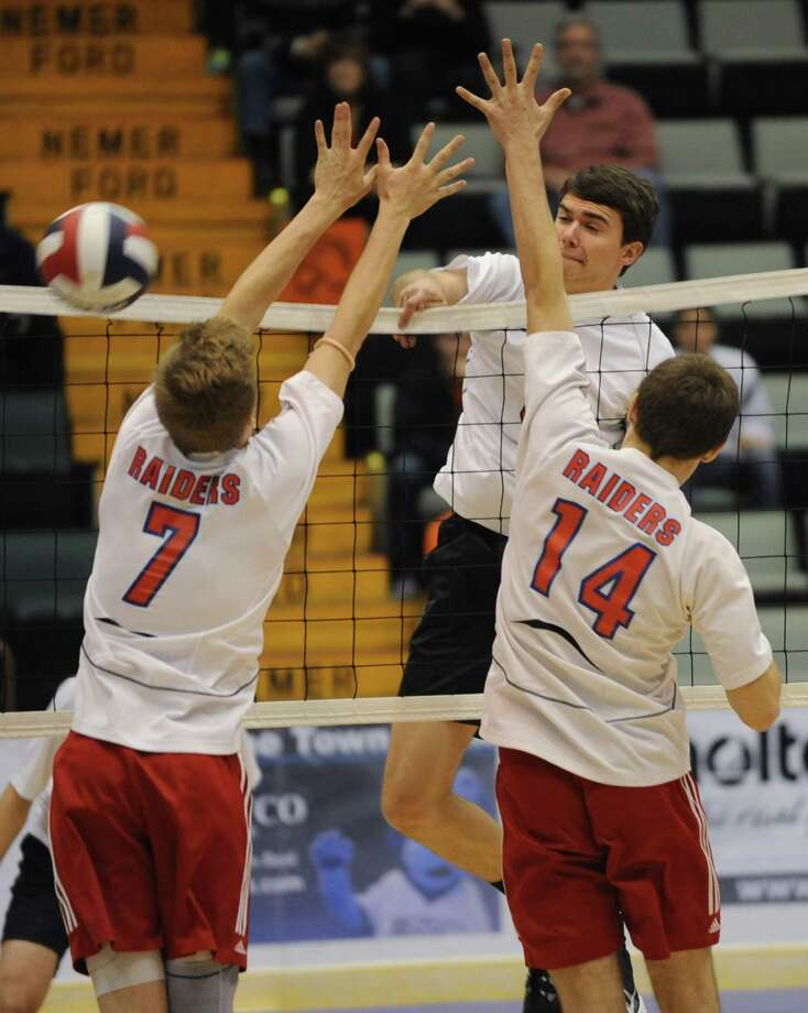 John Sica of Bethlehem drills the ball past Jamie Wolmering, left, and Josh Holm, right, of Fairport during a state semifinals volleyball match on Friday, Nov. 15, 2013 in Glens Falls, N.Y.  (Lori Van Buren / Times Union) Photo: Lori Van Buren / 00024609A
