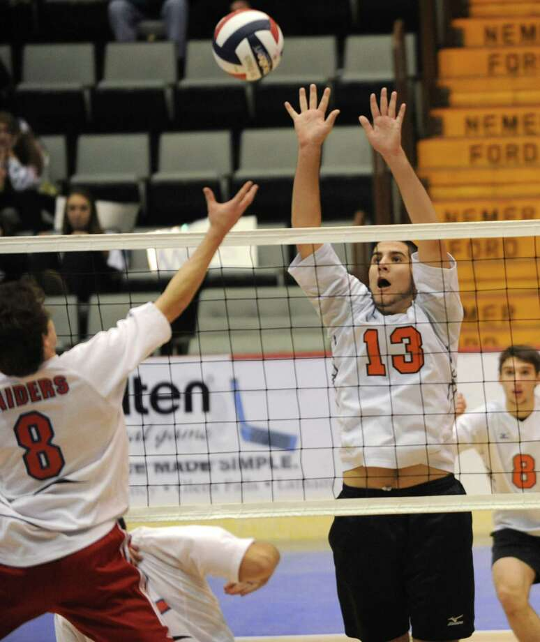 Bethlehem's Joe Foley, right, blocks the ball over the net during a state semifinals volleyball match against Fairport on Friday, Nov. 15, 2013 in Glens Falls, N.Y.  (Lori Van Buren / Times Union) Photo: Lori Van Buren / 00024609A