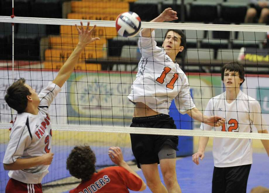 Bethlehem's Dan Ball, #11, hits the ball over the net during a state semifinals volleyball match against Fairport on Friday, Nov. 15, 2013 in Glens Falls, N.Y.  (Lori Van Buren / Times Union) Photo: Lori Van Buren / 00024609A