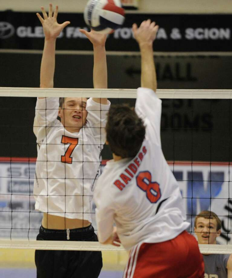 Kevin Cahill of Bethlehem, left, tries to block the ball hit by Troy Riorden of Fairport during a state semifinals volleyball match on Friday, Nov. 15, 2013 in Glens Falls, N.Y.  (Lori Van Buren / Times Union) Photo: Lori Van Buren / 00024609A