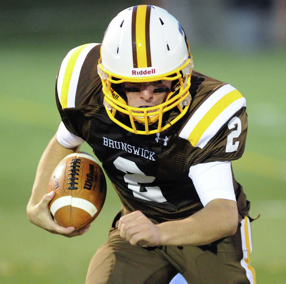 Brunswick quarterback Billy O'Malley (# 2) during the high School football game between Brunswick School and Kent School at Brunswick in Greenwich, Friday night, Sept. 20, 2013. Photo: Bob Luckey / Greenwich Time