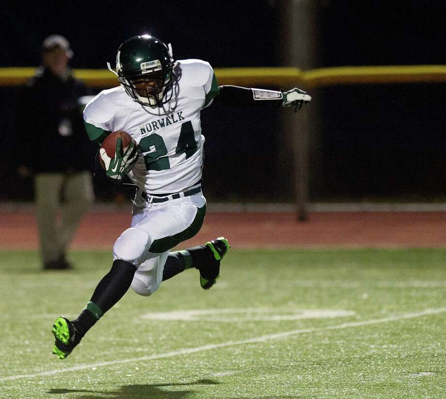 Norwalk's Hopeton Chambers carries the ball during Saturday's football game at Staples High School in Westport, Conn., on November 15, 2013. Photo: Lindsay Perry / Stamford Advocate
