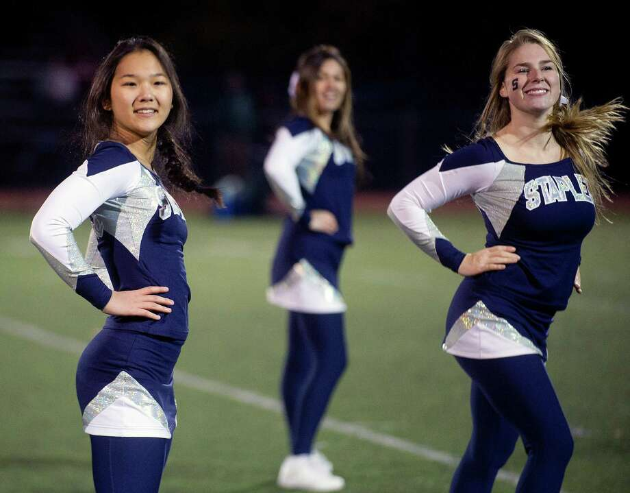 Staples cheerleaders perform during Saturday's football game at Staples High School in Westport, Conn., on November 15, 2013. Photo: Lindsay Perry / Stamford Advocate