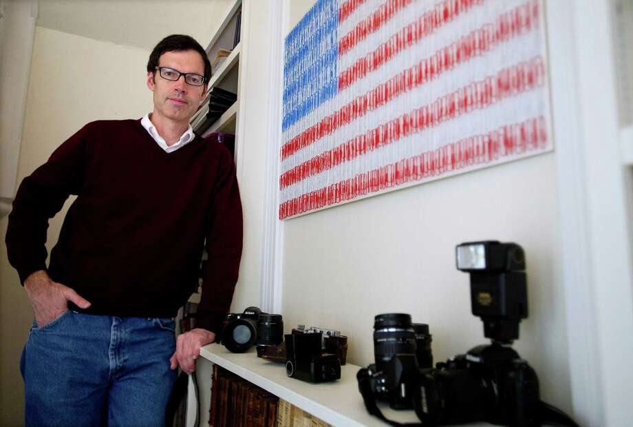 Robert Carley poses for a photo in his Darien home on Friday, November 15, 2013. Carley's photography exhibit of memorials to Newtown tragedy victims will be on display in three Connecticut locations. Photo: Lindsay Perry / Stamford Advocate