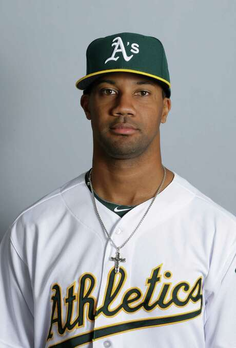 This is a 2013 photo of Chris Young of the Oakland Athletics baseball team. This image reflects the Athletics active roster as of Monday, Feb. 18, 2013.(AP Photo/Darron Cummings) Photo: Darron Cummings, STF / MLBPV AP