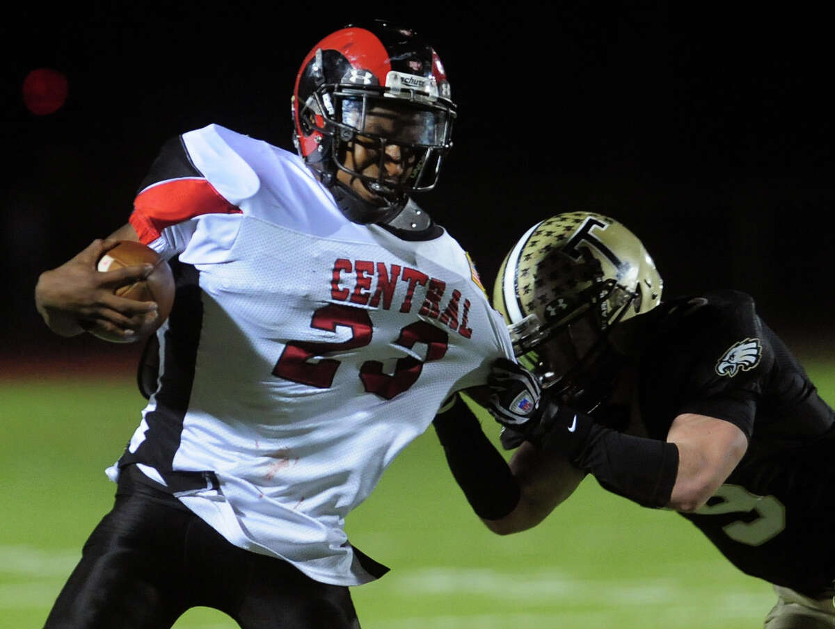 Central QB Mykel Morris can't shake Trumbull's Dan McInerny, during football action in Trumbull, Conn. on Friday November 15, 2013.