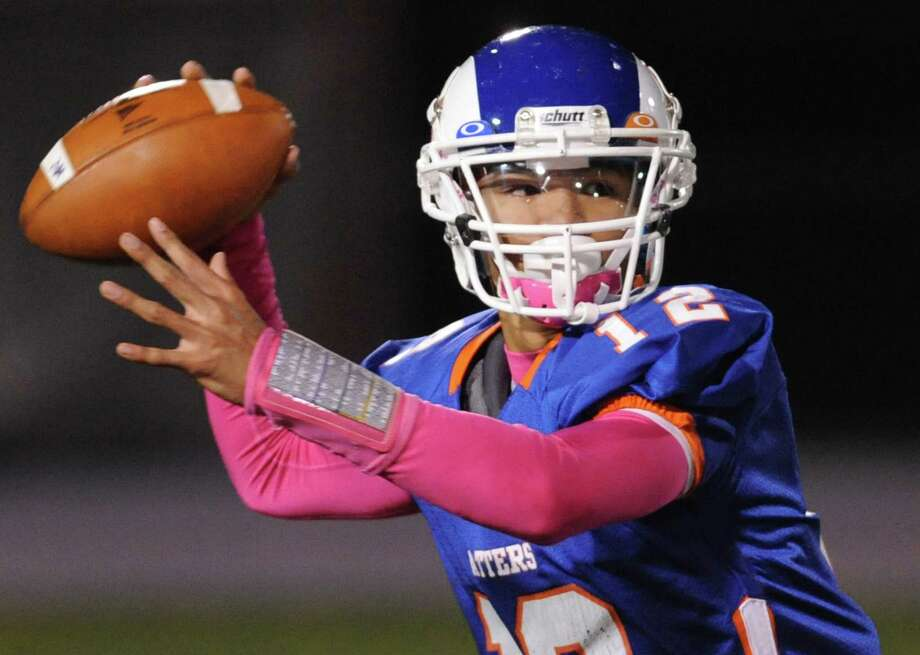 Danbury quarterback Anferny Ith throws a pass in the FCIAC high school football game between Danbury and Greenwich at Danbury High School in Danbury, Conn. on Friday, Nov. 15, 2013. Photo: Tyler Sizemore / The News-Times