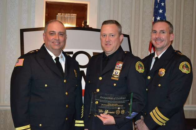 Saratoga Springs Police Officer Mark Leffler, center,was awarded a 2013 Recognition Award from the State STOP-DWI Foundation and Mothers Against Drunk Driving New York State on Nov. 12 at Mallozzi's Restaurant, Schenectady. Leffler has made more than 190 DWI arrests over the past three years including 75 arrests for DWI in 2012, Police Chief Greg Veitch, seen at right, said. At left is Assistant Chief John Catone. (Submitted photo)