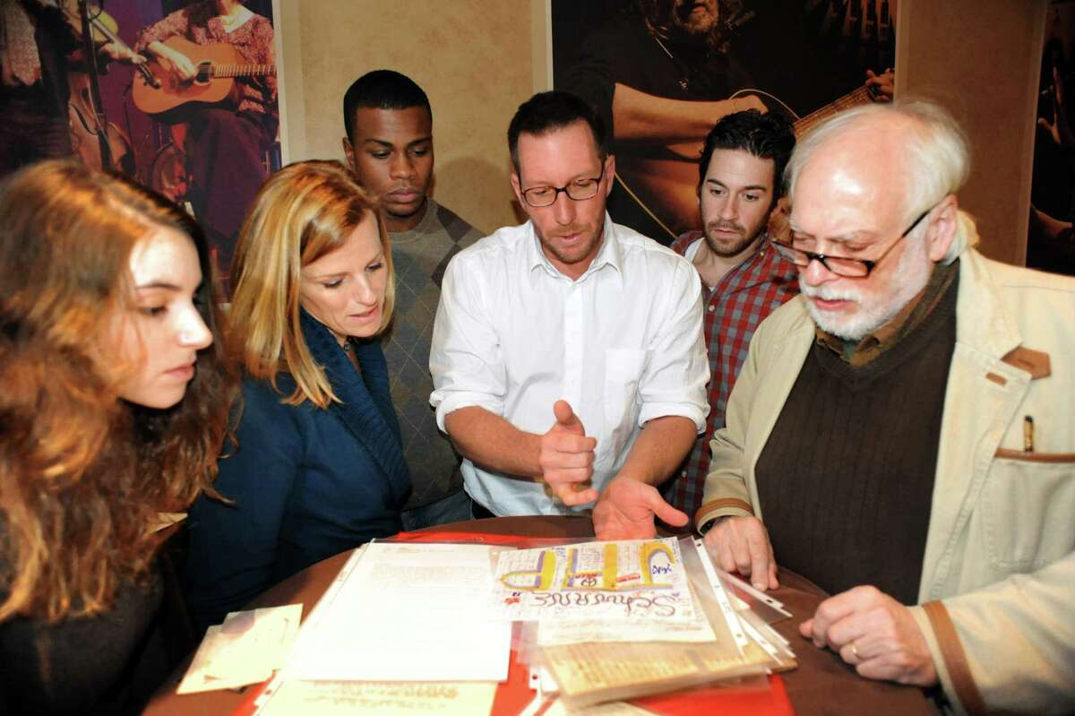 """Writer Andrew Carroll, center, shares letters with actors in the play """"If All the Sky Were Paper"""" on Friday, Nov. 15, 2013, at WAMC's The Linda in Albany, N.Y. The play, written by Carroll, is based on roughly 100,000 unpublished letters from every major American conflict from the American Revolution to modern-day Afghanistan and Iraq. From left are Robyn Belt, Yvonne Perry, Mike Banks, Andrew Carroll, Jonathan Albert and Lary Opitz. (Cindy Schultz / Times Union)"""