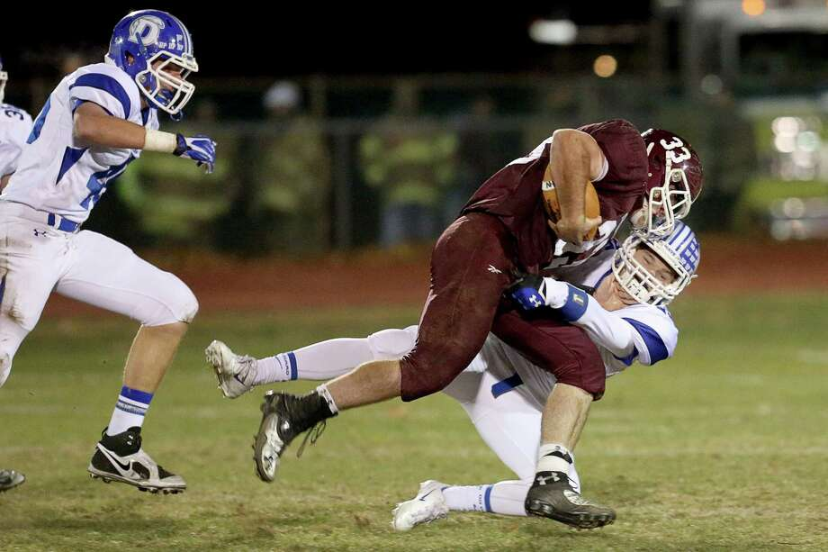 Darien High School's # 25 John Reed makes an attempt to stop North Haven High School's # 33 Ethan Suraci during first half action on Friday evening match-up. Photo: Mike Ross / Mike Ross Connecticut Post freelance - @www.mikerossphoto.com