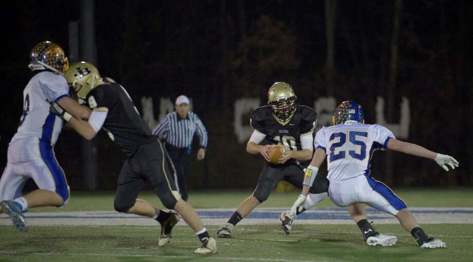 Barlow's Jack Shaban, 10, looks to go past Brookfield's Gabe Pompette, 25, during a SWC football game between Brookfield and Joel Barlow High Schools. Played at Western Connecticut State University, Danbury, Conn, on Friday night, November 15, 2013. Barlow's Bryan Gallare, 9, blocks Bookfield's Robert Drysdale, 9. Photo: H John Voorhees III / The News-Times Freelance