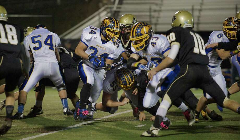 Brookfield's Austin Reich, 34, cuts through the line during a  SWC football game between Brookfield and Joel Barlow High Schools. Played at Western Connecticut State University, Danbury, Conn, on Friday night, November 15, 2013. Photo: H John Voorhees III / The News-Times Freelance