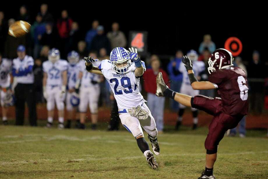 Darien High School's # 29 Myles Ridder gives pressure on North Haven kicker #6 Christopher Brockett during Friday evening's match-up. Photo: Mike Ross / Mike Ross Connecticut Post freelance - @www.mikerossphoto.com