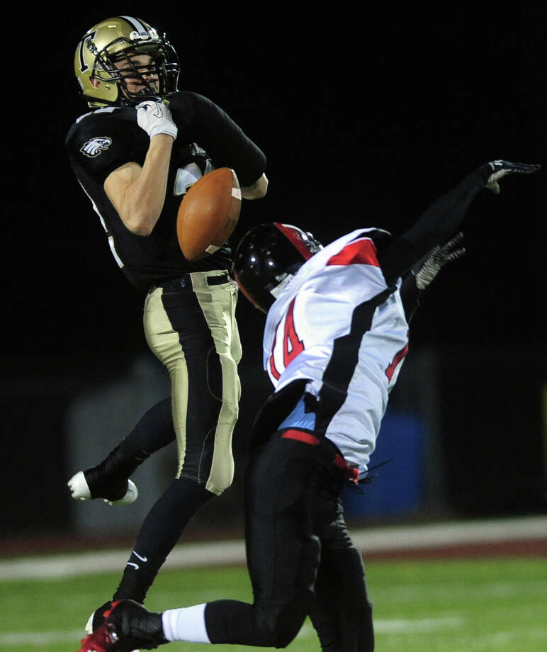 Trumbull's Liam Moore tries but fails to intercept a pass intended for Central's Dominique Hancock, during football action in Trumbull, Conn. on Friday November 15, 2013. Photo: Christian Abraham / Connecticut Post