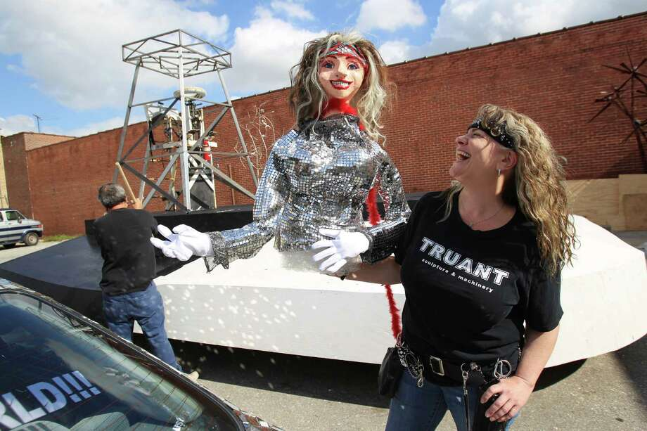 """Nicole Strine, president of Houston Art Car Klub, works on a car float named """"Art Car Capital of the World"""" for the 64th annual Thanksgiving Day Parade. Funding for the parade has reached half a million dollars. Photo: Mayra Beltran, Staff / © 2013 Houston Chronicle"""