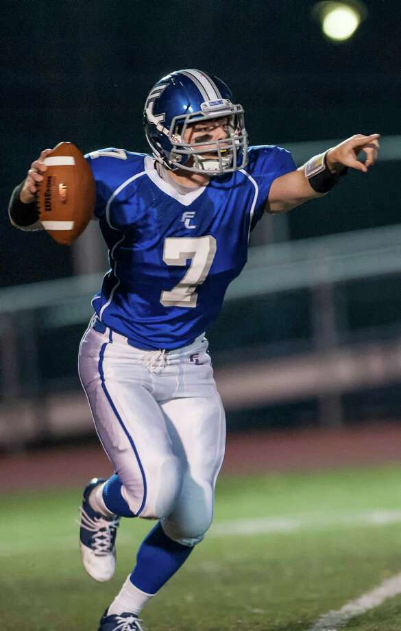 Fairfield Ludlowe high school quarterback Matthew White looks downfield for a receiver during a football game against Stamford high school played at Ludlowe high school, Fairfield, CT on Friday, November, 15th, 2013. Photo: Mark Conrad / Connecticut Post Freelance