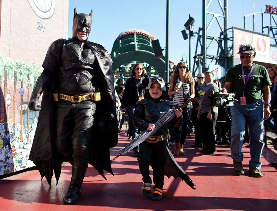 Leukemia survivor Miles, 5, dressed as BatKid, and Batman rescued the San Francisco Giants mascot as part of a Make-A-Wish foundation fulfillment. Miles became a darling of social media Friday, attracting fans from around the country. Photo: Ramin Talaie, Stringer / 2013 Getty Images