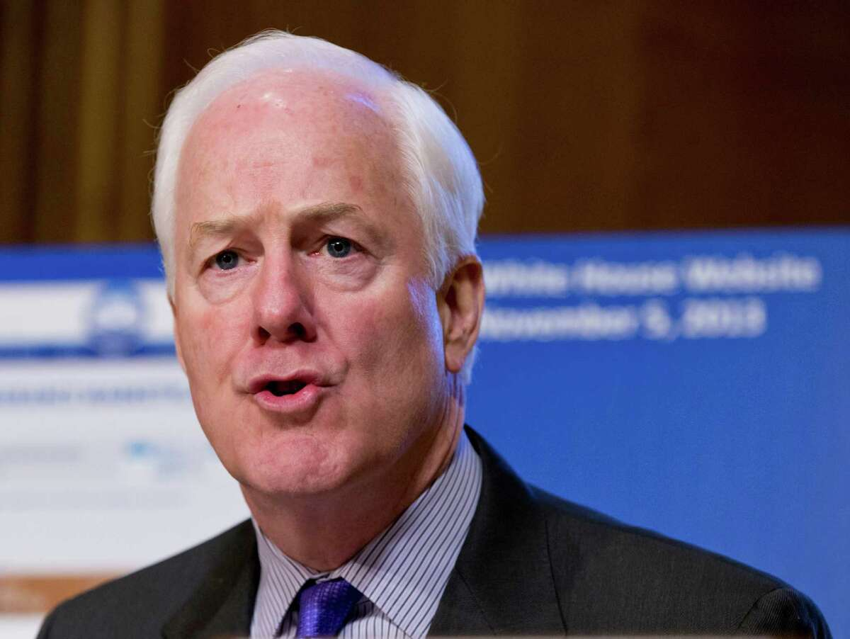 """FILE - In this Nov. 6, 2013 file photo, Sen. John Cornyn, R-Texas speaks on Capitol Hill in Washington. Cornyn called Friday for """"big tent"""" inclusiveness among Republicans and suggested that, moving forward, his party should be the """"responsible adults in the room and actually govern"""", a stark contrast to his junior colleague and fellow Texan, the ideologically fire-breathing Ted Cruz. (AP Photo/J. Scott Applewhite, File)"""