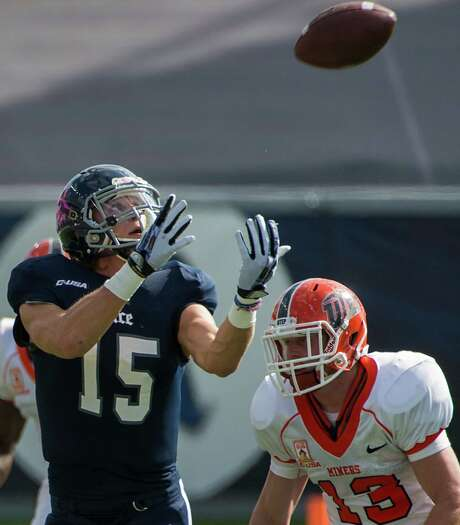 Rice wide receiver Jordan Taylor frequently found himself pursued by defenders during a win over UTEP. Taylor finished with 185 yards and three touchdowns. Photo: Smiley N. Pool, Staff / © 2013  Houston Chronicle