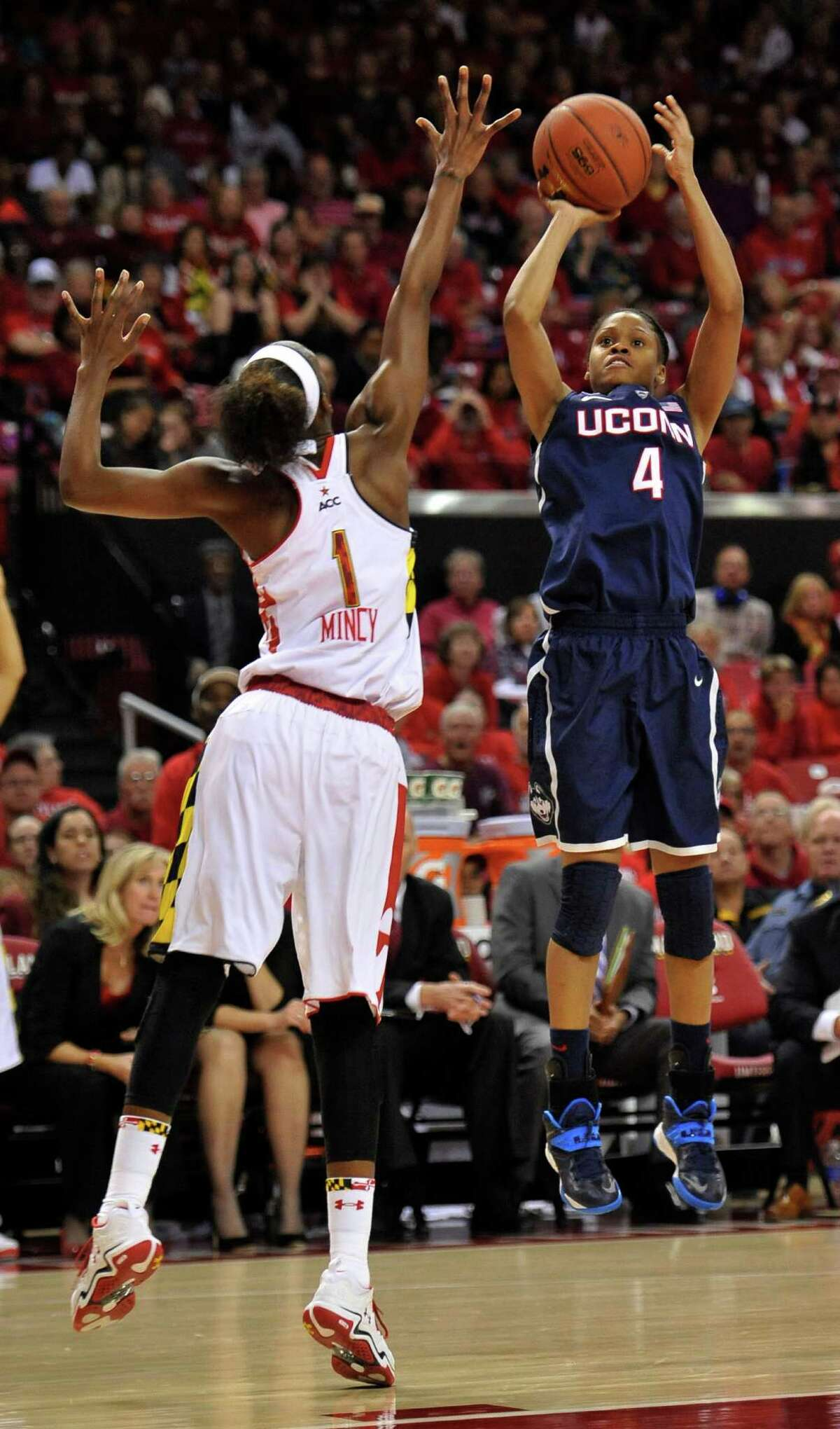 Connecticut's Moriah Jefferson shoots as Maryland's Laurin Mincy tries to block in the first half of an NCAA basketball game Friday, Nov. 15, 2013 in College Park, Md.(AP Photo/Gail Burton)