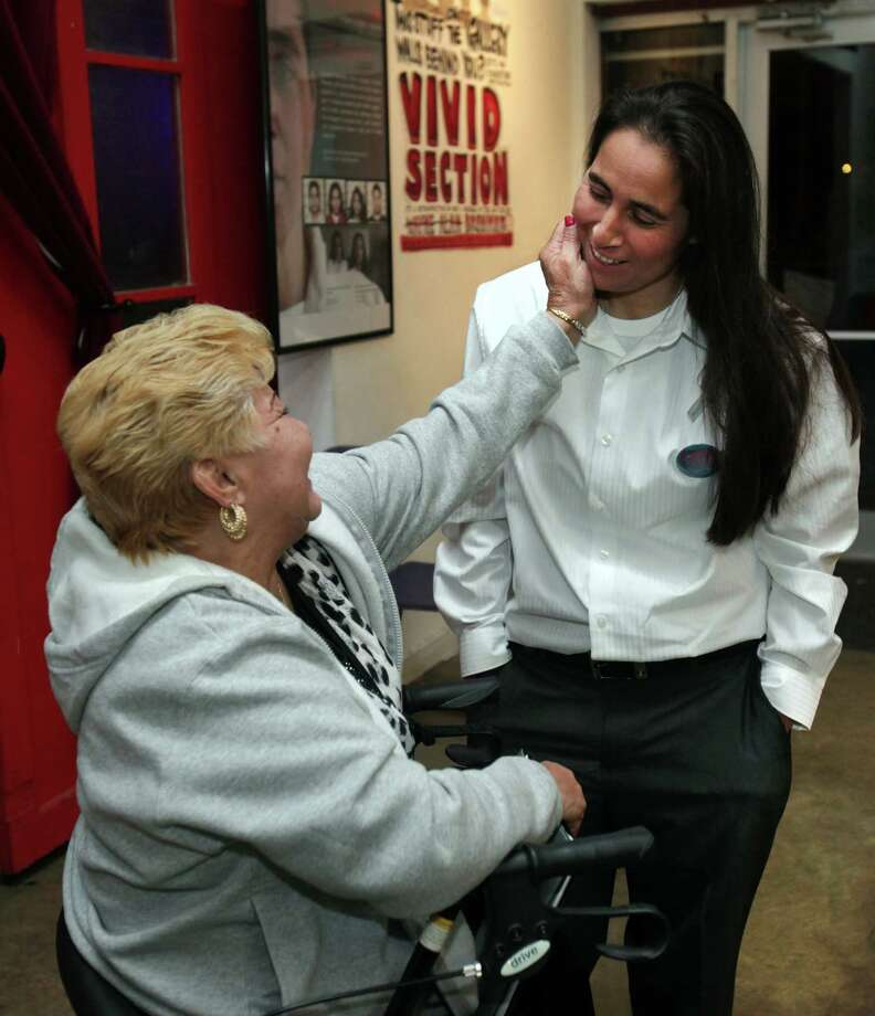"""Anna Vasquez is greeted by Gloria Herrera during a Work-In-Progress screening of """"San Antonio Four"""" a documentary by Deborah S. Esquenazi, on Thursday, Nov. 14, 2013 in Austin.  Three of four San Antonio women imprisoned for sexually assaulting two girls in 1994 could soon walk free after their attorney and prosecutors agreed that a key expert witness' testimony is now discredited.  Bexar County prosecutor Rico Valdez and defense attorney Mike Ware told The Associated Press on Friday, Nov. 15, 2013,  that they agree the convictions of the so-called """"San Antonio 4"""" should be vacated.  Elizabeth Ramirez, Kristie Mayhugh and Cassandra Rivera remain imprisoned. Vasquez, was paroled last year, but under strict conditions. (AP Photo/The San Antonio Express-News, Bob Owen)  RUMBO DE SAN ANTONIO OUT; NO SALES Photo: Bob Owen, MBO / The San Antonio Express-News"""