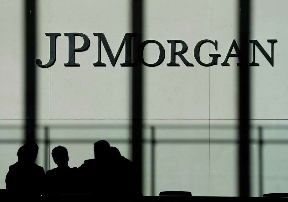 FILE - In this Monday, Oct. 21, 2013., file photo, the JPMorgan Chase & Co. logo is displayed at their headquarters in New York. JPMorgan Chase & Co. said Friday, Nov. 15, 2013, it has reached a $4.5 billion settlement with investors over mortgage-backed securities. (AP Photo/Seth Wenig, File) Photo: Seth Wenig, STF / AP