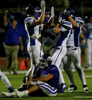 Angleton High School's quarterback Thomas Josey reacts after Friendswood High School's Eric Langston sacked him during the final minutes of their matchup at Wildcat Stadium, Friday, Nov. 15, 2013, in Angleton. Friendswood won 28-20. Photo: Cody Duty, Houston Chronicle / © 2013 Houston Chronicle