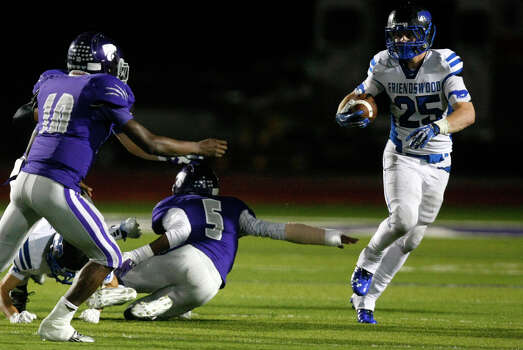 Friendswood High School's Sam Longbotham looks for open room as he shakes a tackle from Angleton High School's Kydron Butler, left, and Jaret Tolbert, center, during the first half of their matchup at Wildcat Stadium, Friday, Nov. 15, 2013, in Angleton. Photo: Cody Duty, Houston Chronicle / © 2013 Houston Chronicle
