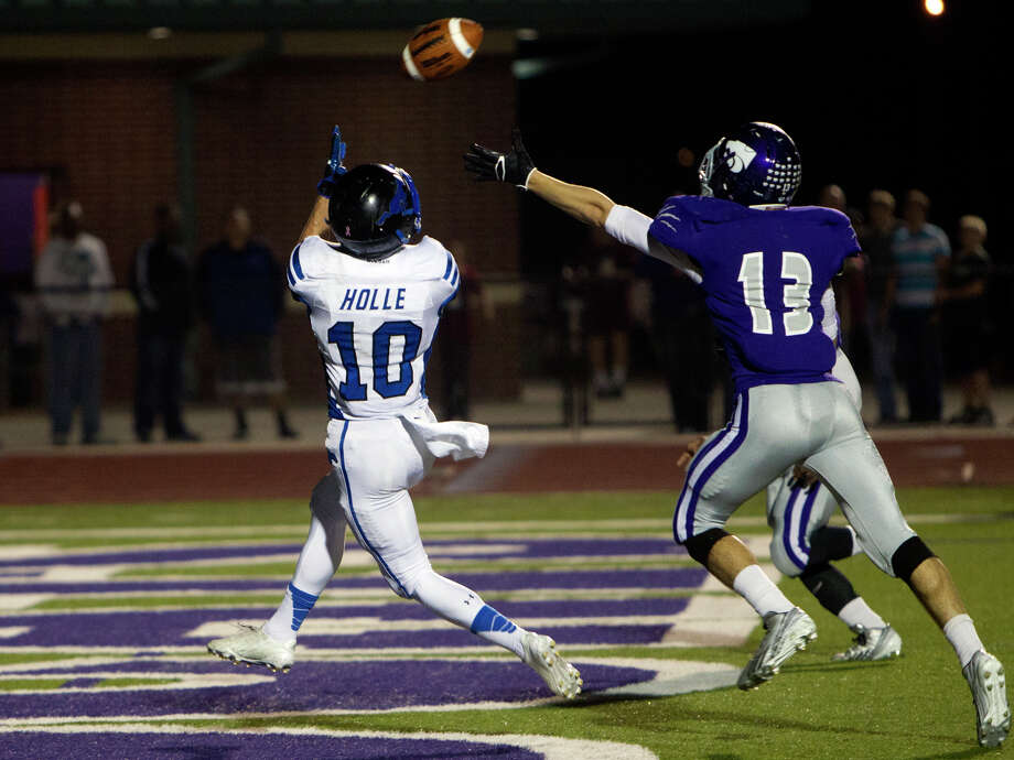 Friendswood High School Slade Holle catches a touchdown pass as Angleton High School's Ty Martinez, right, pressures, during the first half of their matchup at Wildcat Stadium, Friday, Nov. 15, 2013, in Angleton. Photo: Cody Duty, Houston Chronicle / © 2013 Houston Chronicle