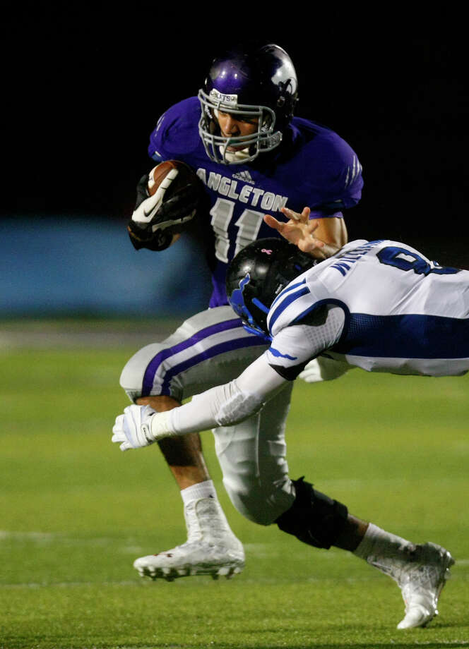 Angleton High School's quarterback Thomas Josey is wrapped up by Friendswood High School's Walker Williams during the second half of their matchup at Wildcat Stadium, Friday, Nov. 15, 2013, in Angleton. Friendswood won 28-20. Photo: Cody Duty, Houston Chronicle / © 2013 Houston Chronicle