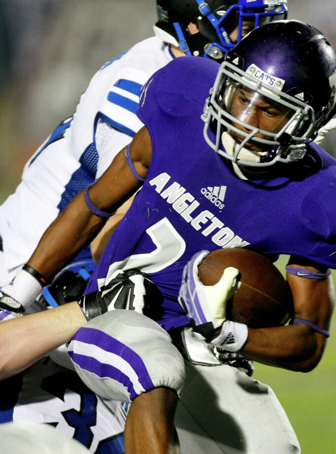 Friendswood High School defenders wrap up Angleton High School's K'Vonte Jackson on the 34-yard line during the second half of their matchup at Wildcat Stadium, Friday, Nov. 15, 2013, in Angleton. Friendswood won 28-20. Photo: Cody Duty, Houston Chronicle / © 2013 Houston Chronicle